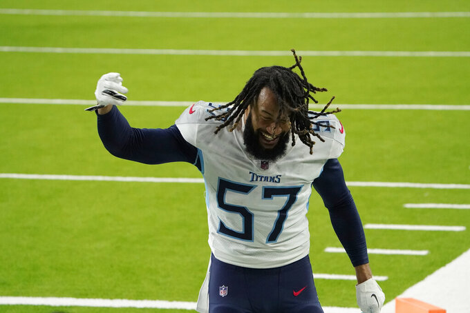 Tennessee Titans' Wyatt Ray (57) celebrates after an NFL football game against the Houston Texans Sunday, Jan. 3, 2021, in Houston. The Titans won 41-38. (AP Photo/Sam Craft)