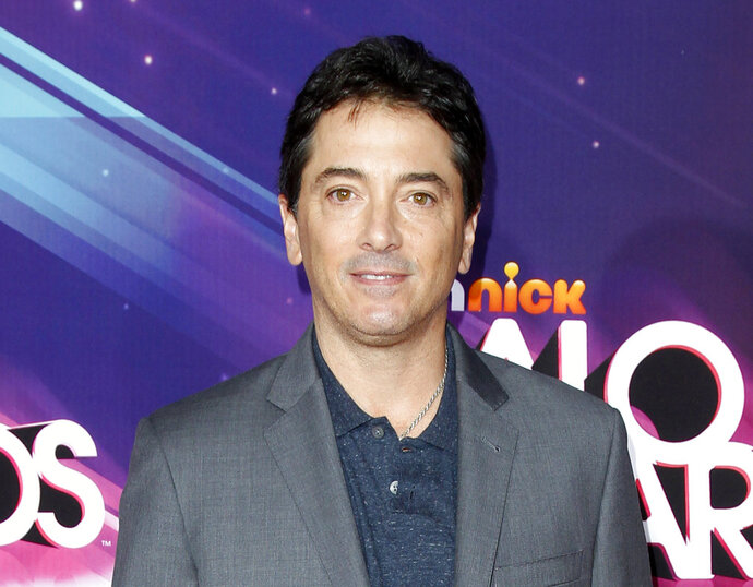 """FILE - In this Nov. 17, 2012 file photo, actor Scott Baio arrives at the TeenNick HALO Awards in Los Angeles. Former """"Charles in Charge"""" actor Alexander Polinsky says Baio assaulted and """"mentally tortured"""" him during their time together on the show in the 1980s. Polinsky made the allegations Wednesday, Feb. 14, 2018, in Los Angeles during a news conference called by his attorney. (Photo by Joe Kohen/Invision/AP, File)"""