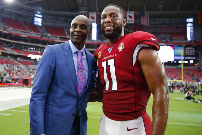 Arizona Cardinals wide receiver Larry Fitzgerald (11) poses with NFL hall of famer Jerry Rice after an NFL football game against the Seattle Seahawks, Sunday, Sept. 29, 2019, in Glendale, Ariz. (AP Photo/Rick Scuteri)