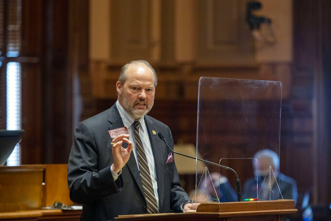 Rep. Barry Fleming, Chairman of the Special Committee on Election Integrity, speaks in defense of SB 202 during a debate in the House Chambers in a legislative session at the Georgia State Capitol Building in Atlanta, Thursday, March 25, 2021. The Georgia state House has passed legislation brought by Republicans that could lead to a sweeping overhaul of state election law. Proposed changes include provisions adding new requirements and restrictions on absentee voting and giving the GOP-led legislature greater control over the administration of elections. (Alyssa Pointer/Atlanta Journal-Constitution via AP)