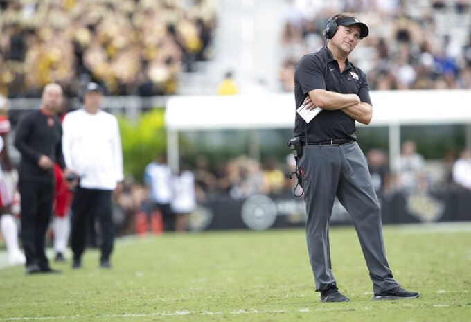 Houston head coach Dana Holgorsen watches a play review on the scoreboard during the second half of an NCAA college football game against Central Florida in Orlando, Fla., Saturday, Nov. 2, 2019. Central Florida won 44-29. (Photo/Willie J. Allen Jr.)