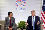 U.S President Donald Trump, right, with Japanese Prime Minister Shinzo Abe, speaks during a bilateral meeting at the G-7 summit in Biarritz, France, Sunday, Aug. 25, 2019. (AP Photo/Andrew Harnik)