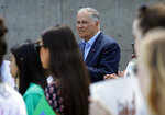 Democratic Presidential candidate Washington Gov. Jay Inslee listens during a climate change rally Friday, May 24, 2019, in Las Vegas. (AP Photo/John Locher)