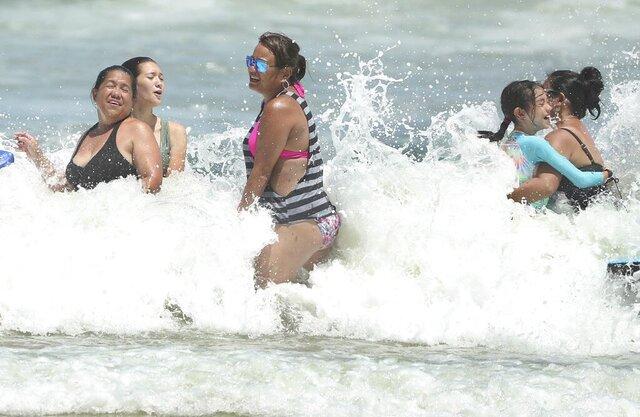 Daytona Beach, Fla., is crowded with beachgoers Saturday, Aug. 1, 2020. Isaias is expected to return to hurricane strength as it nears Florida. (Stephen M. Dowell/Orlando Sentinel via AP)