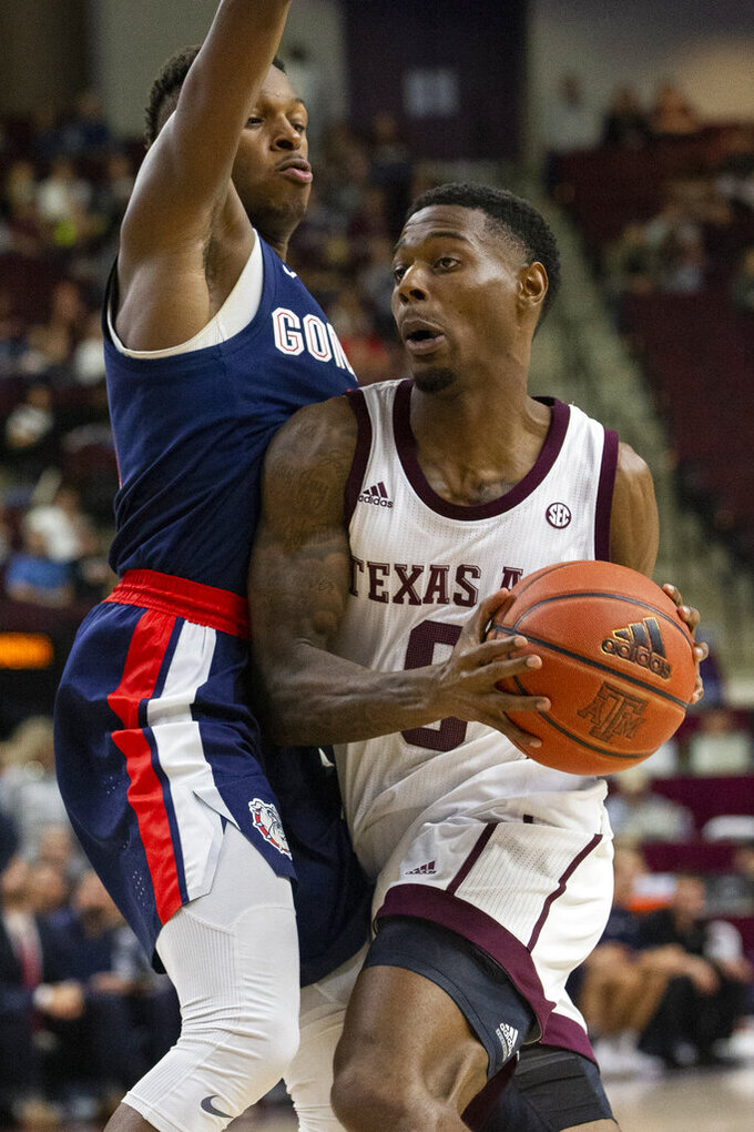 Texas A&M guard Jay Jay Chandler (0) drives the lane against Gonzaga guard Joel Ayayi during the second half of an NCAA college basketball game Friday, Nov. 15, 2019, in College Station, Texas. (AP Photo/Sam Craft)