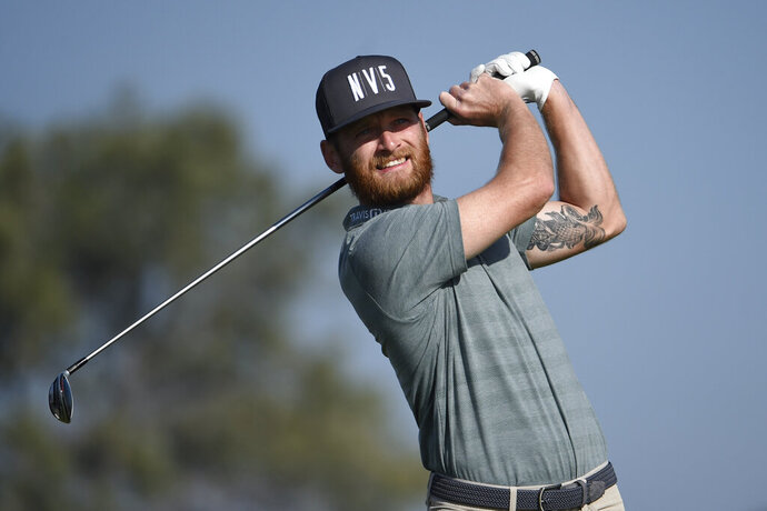FILE - In this Saturday Jan. 25, 2020, file photo, Tyler McCumber hits his tee shot on the second hole of the South Course at Torrey Pines Golf Course during the third round of the Farmers Insurance golf tournament, in San Diego. McCumber is making the most of what amounts to a second chance on the PGA Tour. (AP Photo/Denis Poroy, File)