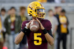 Arizona State quarterback Jayden Daniels (5) warms up for the team's NCAA college football game against Oregon, Saturday, Nov. 23, 2019, in Tempe, Ariz. (AP Photo/Matt York)