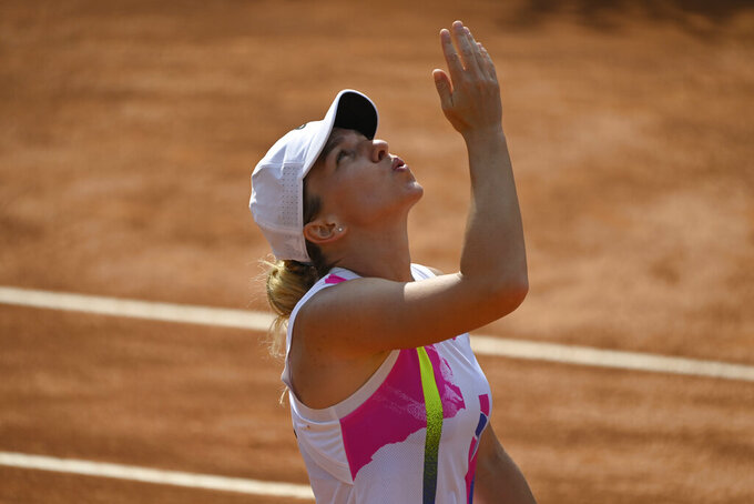 Romania's Simona Halep reacts after winning against Spain's Garbine Muguruza during their semifinal at the Italian Open tennis tournament, in Rome, Sunday, Sept. 20, 2020. (Alfredo Falcone/LaPresse via AP)