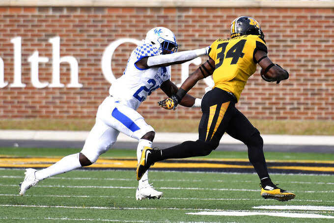 Missouri running back Larry Rountree III (34) runs past Kentucky defensive back Yusuf Corker during the first half of an NCAA college football game Saturday, Oct. 24, 2020, in Columbia, Mo. (AP Photo/L.G. Patterson)
