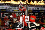 Christopher Bell celebrates in Victory Lane after winning the NASCAR Xfinity Series auto race at Texas Motor Speedway in Fort Worth, Texas, Saturday, Nov. 2, 2019. (AP Photo/Randy Holt)