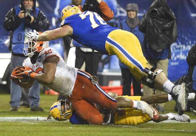 Clemson's Christian Wilkins (42) is tackled by Pittsburgh's Alex Bookser (78) after recovering a Pittsburgh fumble in the first half of the Atlantic Coast Conference championship NCAA college football game in Charlotte, N.C., Saturday, Dec. 1, 2018. (AP Photo/Mike McCarn)