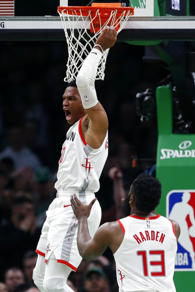Houston Rockets' Russell Westbrook (0) dunks in front of teammate James Harden (13) during the second half of the team's NBA basketball game against the Boston Celtics in Boston, Saturday, Feb. 29, 2020. (AP Photo/Michael Dwyer)