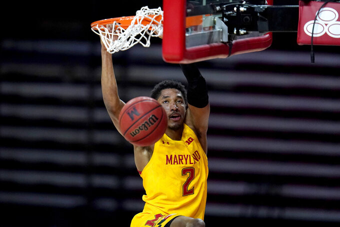 Maryland guard Aaron Wiggins dunks on Michigan State during the second half of an NCAA college basketball game, Sunday, Feb. 28, 2021, in College Park, Md. Maryland won 73-55. (AP Photo/Julio Cortez)
