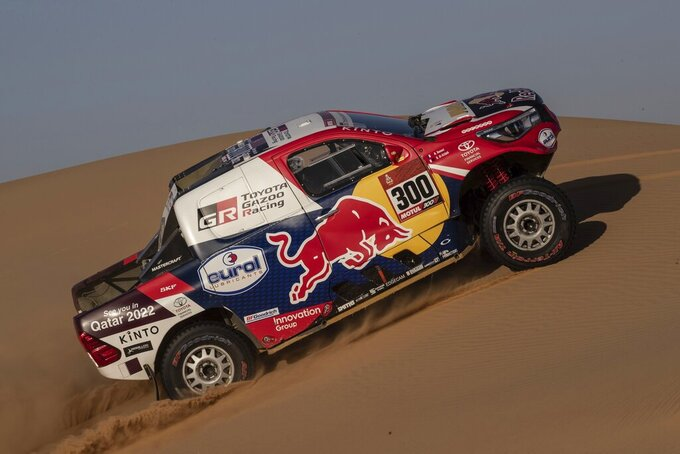 Driver Nasser Al-Attiyah, of Qatar, and co-driver Matthieu Baumel, of France, race their Toyota during stage eight of the Dakar Rally in Wadi Al Dawasir, Saudi Arabia, Monday, Jan. 13, 2020. (AP Photo/Bernat Armangue)