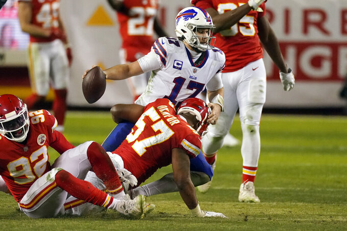 Buffalo Bills quarterback Josh Allen (17) is sacked by Kansas City Chiefs defensive end Alex Okafor (57) during the second half of the AFC championship NFL football game, Sunday, Jan. 24, 2021, in Kansas City, Mo. (AP Photo/Charlie Riedel)