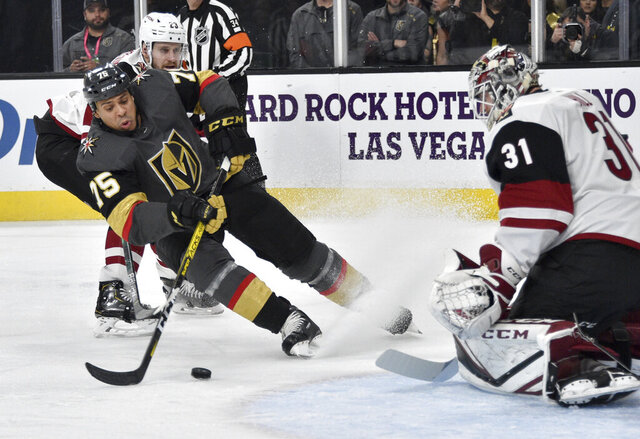Vegas Golden Knights right wing Ryan Reaves (75) shoots against Arizona Coyotes goaltender Adin Hill during the second period of an NHL hockey game Saturday, Dec. 28, 2019, in Las Vegas. (AP Photo/David Becker)