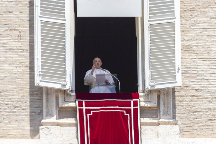 """Pope Francis delivers his message after the Angelus noon blessing from the window of his studio overlooking St. Peter's Square at the Vatican, Sunday, July 12, 2020. In a very brief, improvised remark, Pope Francis, speaking from his studio window overlooking St. Peter's Square, said he is """"deeply pained"""" over the decision by Turkey to change the status of Hagia Sophia, which had originally been built as a Christian cathedral, from that of a museum in Istanbul to a mosque.  (AP Photo/Alessandra Tarantino)"""