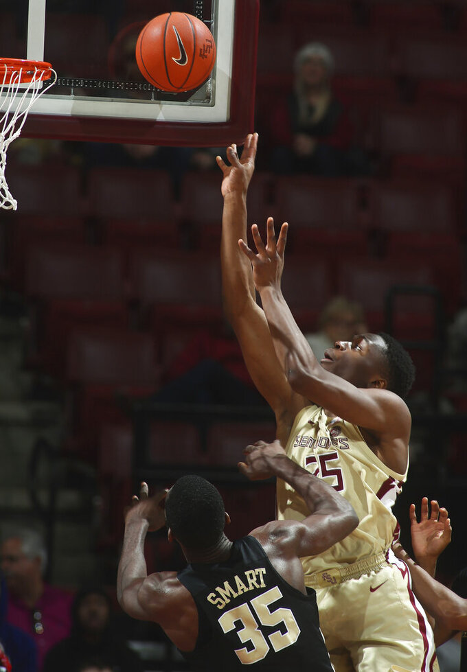 Florida State forward Mfiondu Kabengele (25) makes a layup over Wake Forest forward Ikenna Smart (35) during the second half of an NCAA college basketball game in Tallahassee, Fla., Wednesday, Feb. 13, 2019. Florida State won 88-66. (AP Photo/Phil Sears)