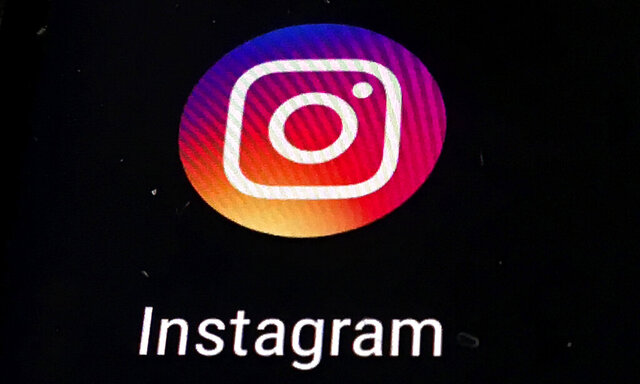 FILE - In this Nov. 29, 2018 file photo, the Instagram app logo is displayed on a mobile screen in Los Angeles. Though Black Out Tuesday was originally organized by the music community, the social media world went dark on Tuesday in support of the Black Lives Matter movement and the many killings of black people around the world that has caused outrage and protests. Instagram accounts, from top record label to everyday people, was full of black squares posted in response to the deaths of George Floyd, Ahmaud Arbery and Breonna Taylor. (AP Photo/Damian Dovarganes, File)
