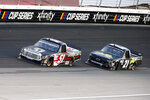 Kyle Busch (51) and Zane Smith (21) come out of Turn 4 during the NASCAR Trucks race at Texas Motor Speedway in Fort Worth, Texas, Saturday, July 18, 2020. (AP Photo/Ray Carlin)