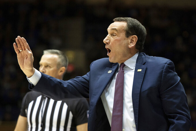 Duke coach Mike Krzyzewski directs his team during the first half of an NCAA college basketball game against Georgia State in Durham, N.C., Friday, Nov. 15, 2019. (AP Photo/Ben McKeown)