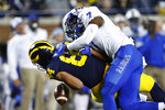 Middle Tennessee safety Jovante Moffatt (7) knocks the ball from Michigan tight end Sean McKeon (84) for an incomplete pass during the second half of an NCAA college football game in Ann Arbor, Mich., Saturday, Aug. 31, 2019. (AP Photo/Paul Sancya)