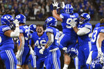 BYU celebrate after a missed field goal by Arizona during the second half of an NCAA college football game Saturday, Sept. 4, 2021, in Las Vegas. (AP Photo/David Becker)
