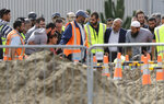 Zaed Mustafa, in wheelchair, brother of Hamza and son of Khalid Mustafa killed in the Friday March 15 mosque shootings reacts at the grave side during the burial at the Memorial Park Cemetery in Christchurch, New Zealand, Wednesday, March 20, 2019. (AP Photo/Mark Baker)