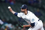 Seattle Mariners relief pitcher Yohan Ramirez throws against the Oakland Athletics in the eighth inning of a baseball game Monday, Sept. 27, 2021, in Seattle. (AP Photo/Elaine Thompson)