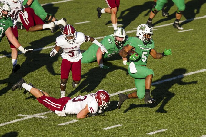 Marshall running back Sheldon Evans (5) breaks through the Massachusetts defense on his way to a touchdown during an NCAA college football game Saturday, Nov. 7, 2020, in Huntington, W.Va. (Sholten Singer/The Herald-Dispatch via AP)