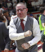 Virginia Tech coach Buzz Williams celebrates the team's 77-72 win over Duke in an NCAA college basketball game Tuesday, Feb. Feb. 26, 2019, in Blacksburg, Va. (Matt Gentry/The Roanoke Times via AP)