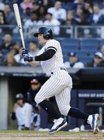 New York Yankees' Clint Frazier follows through on a single during the sixth inning of a baseball game against the Detroit Tigers Wednesday, April 3, 2019, in New York. (AP Photo/Frank Franklin II)