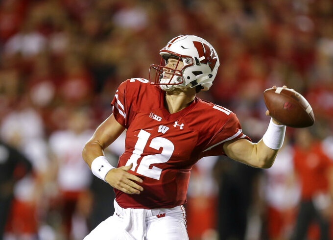 FILE - In this Aug. 31, 2018, file photo, Wisconsin quarterback Alex Hornibrook throws a pass against Western Kentucky during the first half of an NCAA college football game, in Madison, Wis. Tight end Zander Neuville returned last week from injury and receiver Danny Davis is due back from suspension. Two more targets for Hornibrook. (AP Photo/Andy Manis, File)