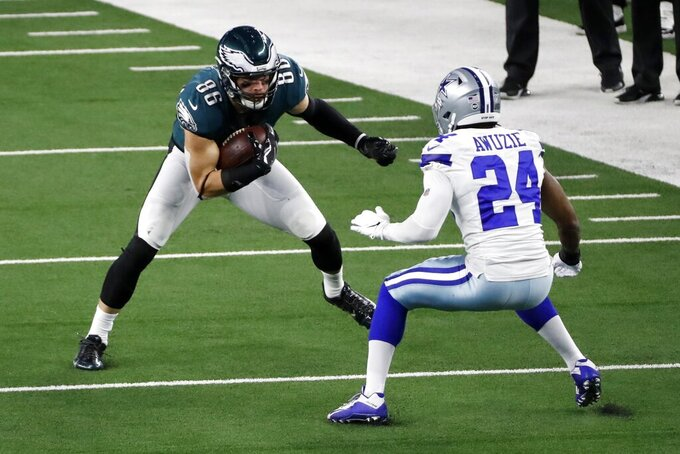 Philadelphia Eagles tight end Zach Ertz (86) attempts to get past Philadelphia Eagles cornerback Darius Slay (24) after catching a pass in the second half of an NFL football game in Arlington, Texas, Sunday, Dec. 27. 2020. (AP Photo/Roger Steinman)