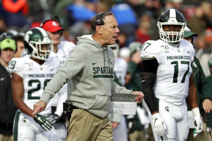 Michigan State head coach Mark Dantonio argues a call during the first half of an NCAA college football game against Rutgers on Saturday, Nov. 23, 2019, in Piscataway, N.J. Michigan State won 27-0. (AP Photo/Adam Hunger)