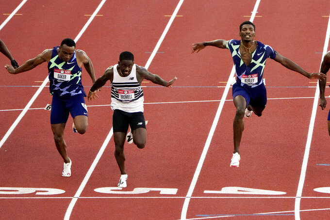 Trayvon Bromell wins the men's 100-meter run at the U.S. Olympic Track and Field Trials Sunday, June 20, 2021, in Eugene, Ore. (AP Photo/Chris Carlson)