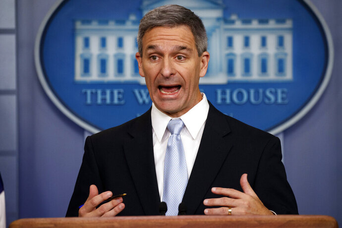 FILE - In this Aug. 12, 2019, file photo, acting Director of United States Citizenship and Immigration Services Ken Cuccinelli speaks during a briefing at the White House, Monday, Aug. 12, 2019, in Washington. Cuccinelli defended the effort to effectively end asylum at the U.S.-Mexico border for nearly all migrants, saying Frida, Sept. 13 it was necessary to drive down a massive backlog of immigration cases. (AP Photo/Evan Vucci, File)