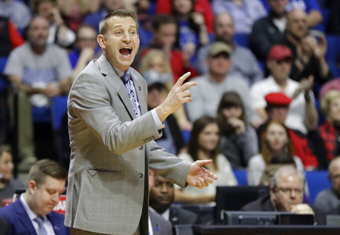 Buffalo head coach Nate Oats is seen on the sidelines during the first half of a second round men's college basketball game against Texas Tech in the NCAA Tournament Sunday, March 24, 2019, in Tulsa, Okla. (AP Photo/Jeff Roberson)