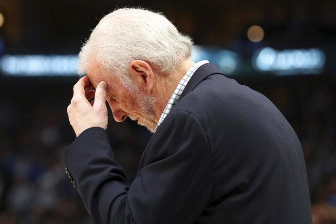 San Antonio Spurs head coach Gregg Popovich reacts near the end of an NBA football game against the Dallas Mavericks, Monday, Nov. 18, 2019, in Dallas. (AP Photo/Richard W. Rodriguez)