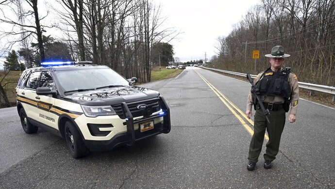 A Tennessee Highway Patrol trooper blocks the road to McGhee Tyson Air National Guard Base after reports were received of shots being fired Wednesday, Jan. 15, 2020, in Alcoa, Tenn. (AP Photo/Michael Patrick)