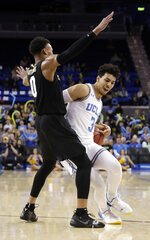 UCLA guard Jules Bernard (3) is defended by Colorado guard Shane Gatling (0) during the second half of an NCAA college basketball game Wednesday, Feb. 6, 2019, in Los Angeles. (AP Photo/Marcio Jose Sanchez)