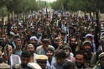 FILE - In this June 23, 2021 file photo, Afghan militiamen join Afghan defense and security forces during a gathering in Kabul, Afghanistan. The US and NATO have promised to pay $4 billion a year until 2024 to finance Afghanistan's military and security forces, which are struggling to contain an advancing Taliban. Already since 2001, the U.S. has spent nearly $89 billion to build, equip and train the forces. (AP Photo/Rahmat Gul, File)