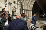"""American actor Johnny Depp arrives at the High Court in London, Monday, July 13, 2020.  Depp is expected to wrap up his evidence at his libel trial against a tabloid newspaper that accused him of abusing ex-wife Amber Heard. The Hollywood star is suing News Group Newspapers, publisher of The Sun, and the paper's executive editor, Dan Wootton, over an April 2018 article that called him a """"wife-beater.""""  (AP Photo/Matt Dunham)"""
