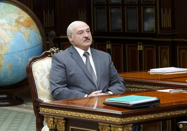 Belarusian President Alexander Lukashenko listens to Valiantsin Sukala, head of the Supreme Court of Belarus during their meeting in Minsk, Belarus, Monday, Aug. 31, 2020. (Nikolai Petrov/BelTA Pool Photo via AP)
