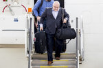 Washington Capitals head coach Barry Trotz arrives with the team at Dulles International Airport in Sterling, Va., Friday, June 8, 2018, the day after defeating the Vegas Golden Knights in Game 5 of the NHL hockey Stanley Cup Finals. (AP Photo/Andrew Harnik)