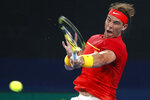 Rafael Nadal of Spain plays a shot against David Goffin of Belgium during their ATP Cup tennis match in Sydney, Friday, Jan. 10, 2020. (AP Photo/Steve Christo)