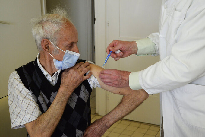 FILE - In this April 1, 2021, file photo, general practitioner Gyorgy Teleki vaccinates an elderly patient with the second dose of COVID-19 vaccine produced by Chinese Sinopharm in Taplanszentkereszt, Hungary. A new study suggests that a Sinopharm vaccine offers poor protection from COVID-19 among the elderly, raising questions for dozens of countries that have given the Chinese company's shots to their most vulnerable populations. (Istvan Filep/MTI via AP, File)