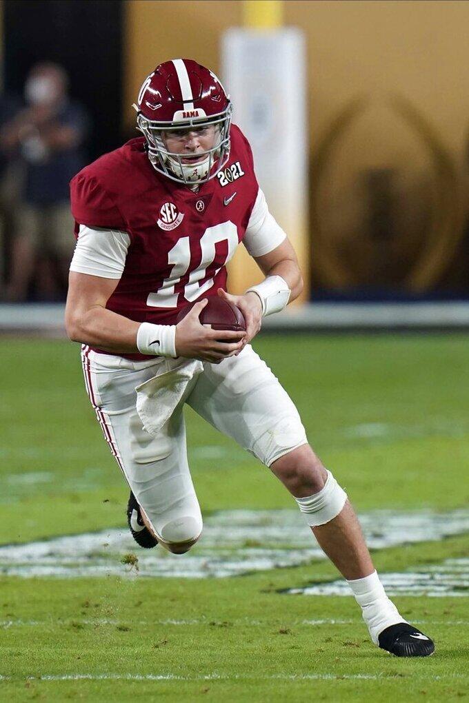 Alabama quarterback Mac Jones runs against Ohio State during the first half of an NCAA College Football Playoff national championship game, Monday, Jan. 11, 2021, in Miami Gardens, Fla. (AP Photo/Chris O'Meara)