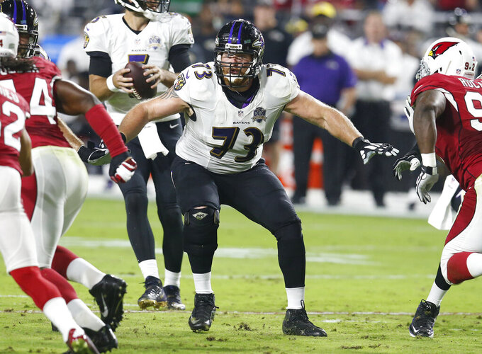 FILE - In this Oct. 26, 2015, file photo, Baltimore Ravens guard Marshal Yanda (73) blocks during an NFL football game against the Arizona Cardinals, in Glendale, Ariz. Yanda is retiring after 13 seasons in which he was named to the Pro Bowl eight times and helped Baltimore win the 2012 Super Bowl. (AP Photo/Rick Scuteri, File)