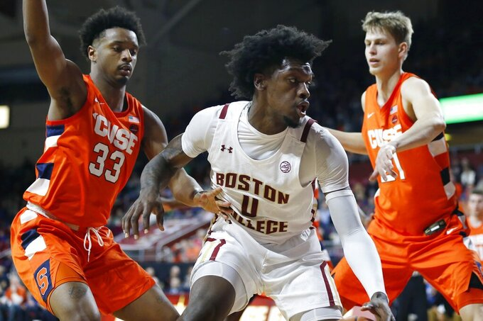 Syracuse's Elijah Hughes (33) and Marek Dolezaj (21) defends against Boston College's CJ Felder (0) during the first half of an NCAA college basketball game, Tuesday, March, 3, 2020, in Boston. (AP Photo/Michael Dwyer)